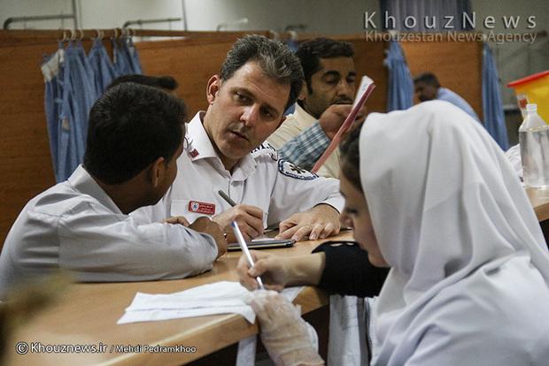 تصاویر/ اورژانس بیمارستان امام اهواز در یک روز خاکی / 1